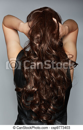 woman with long brown curly hair - csp9773403