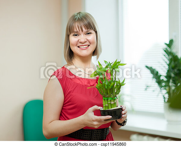 woman with lucky bamboo plant - csp11945860