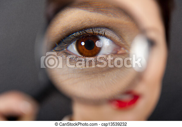 Woman with magnifier on white background - csp13539232