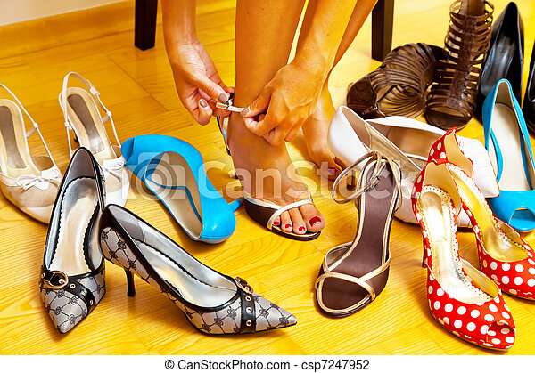 Woman with many shoes to choose from - csp7247952