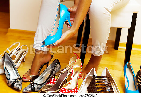 a young woman has many different shoes to choose from