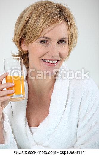 Woman with orange juice - csp10963414