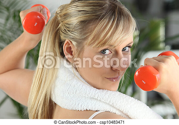 Woman with orange weights - csp10483471