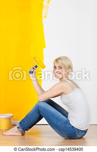 Woman With Paint Roller Sitting On Floor - csp14539400