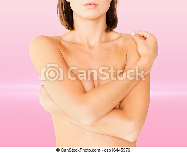 woman with perfect skin and hands over breast - csp16445379