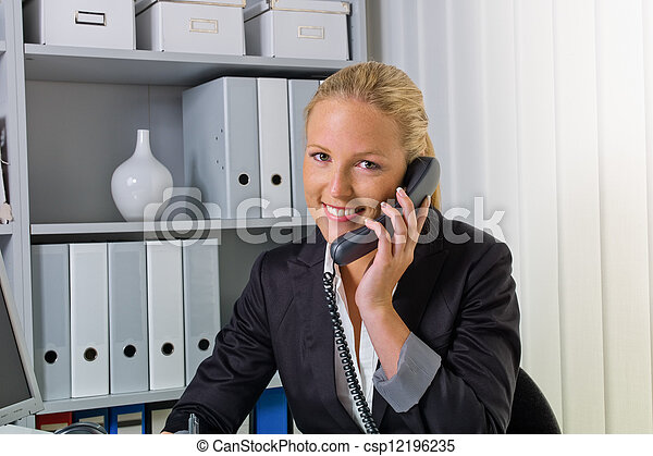 woman with phone in office - csp12196235