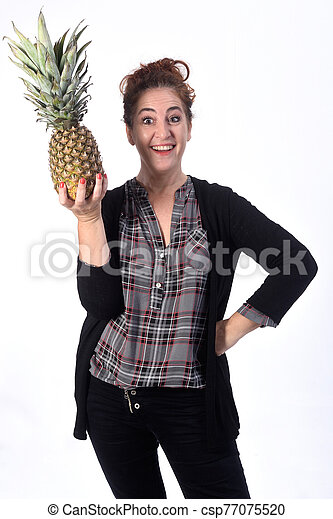 woman with pineapple on white background - csp77075520