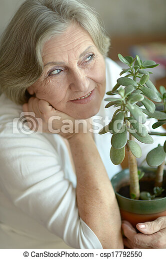 woman with plant - csp17792550