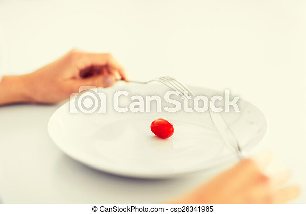 woman with plate and one tomato - csp26341985