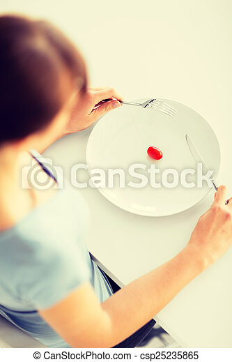 woman with plate and one tomato - csp25235865