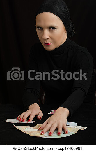 woman with playing cards and money - csp17460961