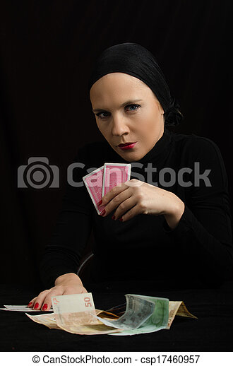 woman with playing cards and money - csp17460957