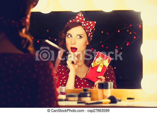 woman with present box near a mirror. - csp27863599