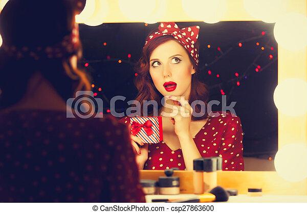 woman with present box near a mirror. - csp27863600
