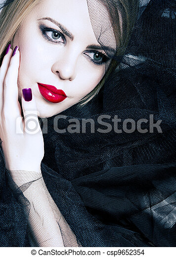 woman with red lips in black veil - csp9652354