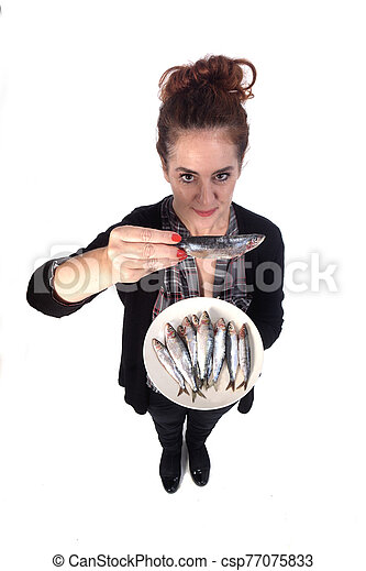 woman with sardine on white background - csp77075833
