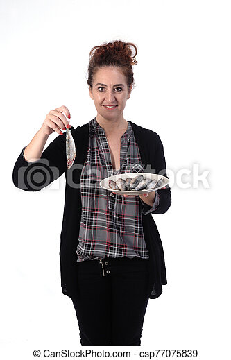 woman with sardine on white background - csp77075839