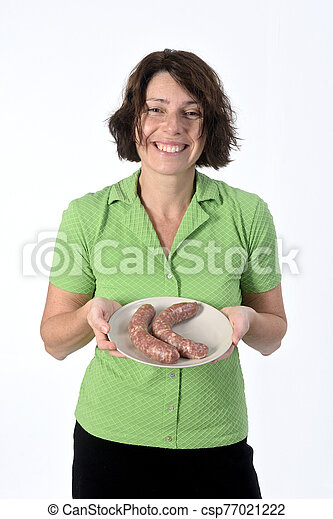 woman with sausage on white background - csp77021222