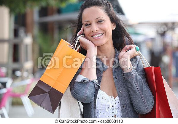 Woman with shopping bags - csp8863110