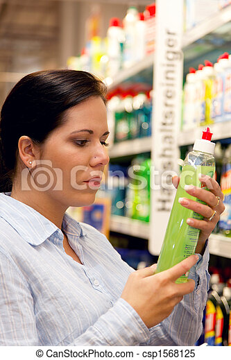 Woman with shopping basket in the supermarket - csp1568125