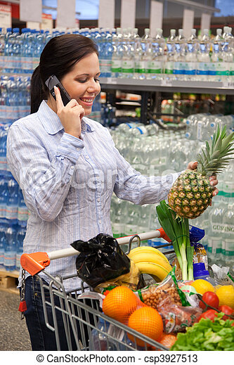 Woman with shopping basket in the supermarket - csp3927513
