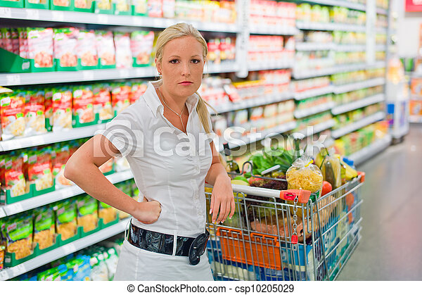 woman with shopping cart in the supermarket - csp10205029