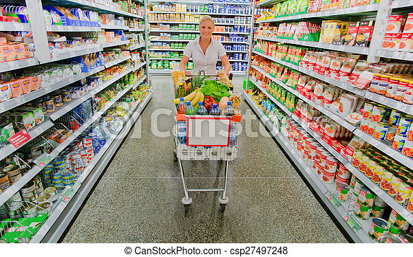 woman with shopping cart in the supermarket - csp27497248