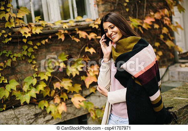 Woman with telephon outdoor - csp41707971