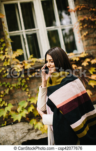 Woman with telephon outdoor - csp42077676