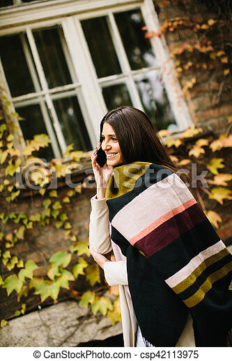 Woman with telephon outdoor - csp42113975