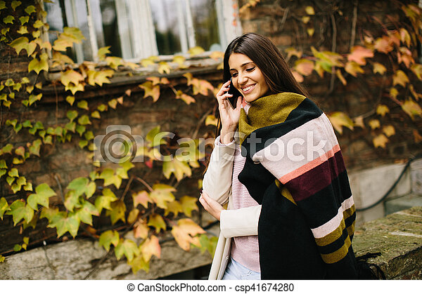 Woman with telephon outdoor - csp41674280