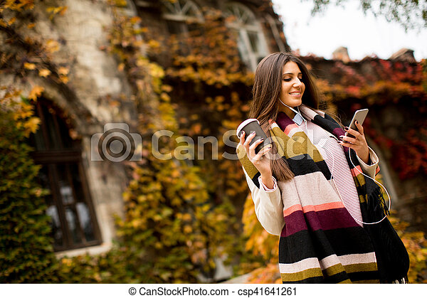 Woman with telephon outdoor - csp41641261