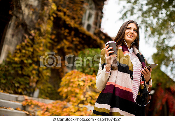 Woman with telephon outdoor - csp41674321