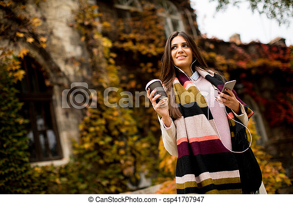 Woman with telephon outdoor - csp41707947