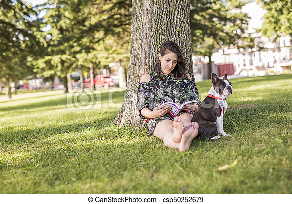 woman with terrier dog outside at the park - csp50252679