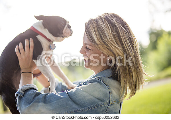 woman with terrier dog outside at the park - csp50252682