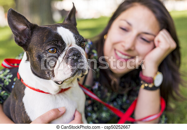 woman with terrier dog outside at the park - csp50252667