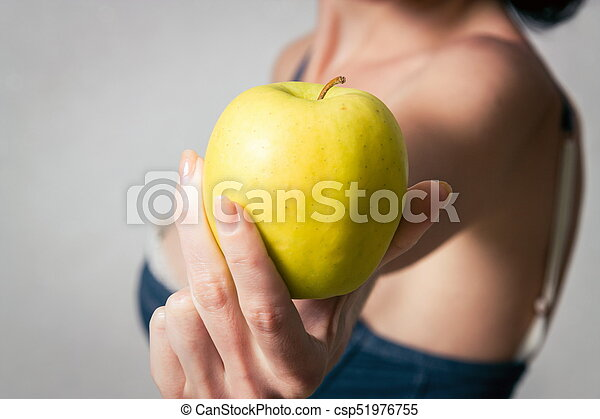 Woman with the apple - csp51976755