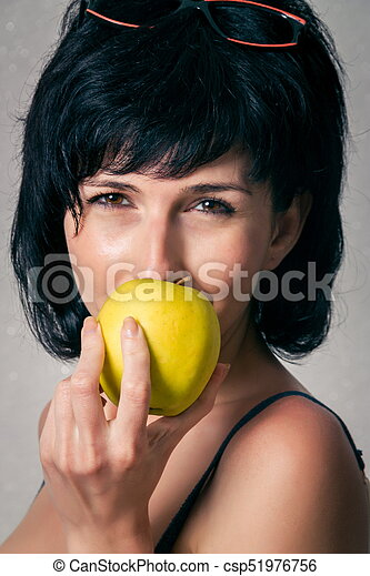 Woman with the apple - csp51976756
