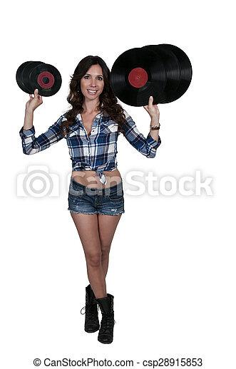 Woman with vinyl records - csp28915853