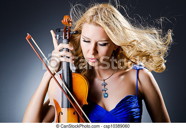 Woman with violin in studio - csp10389060
