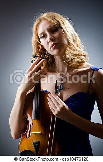 Woman with violin in studio - csp10476120