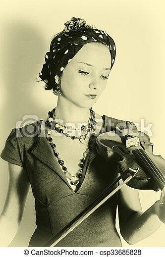 Woman with violin - csp33685828