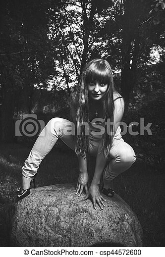 woman with vulturous stare in the forest - csp44572600