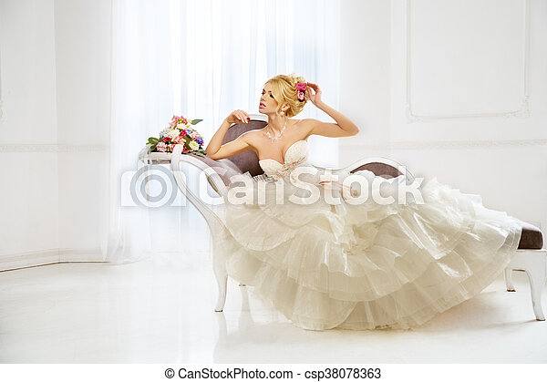 Woman with wedding dress, hair and make up - csp38078363
