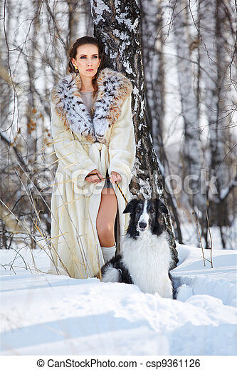 woman with wolfhound outdoors - csp9361126
