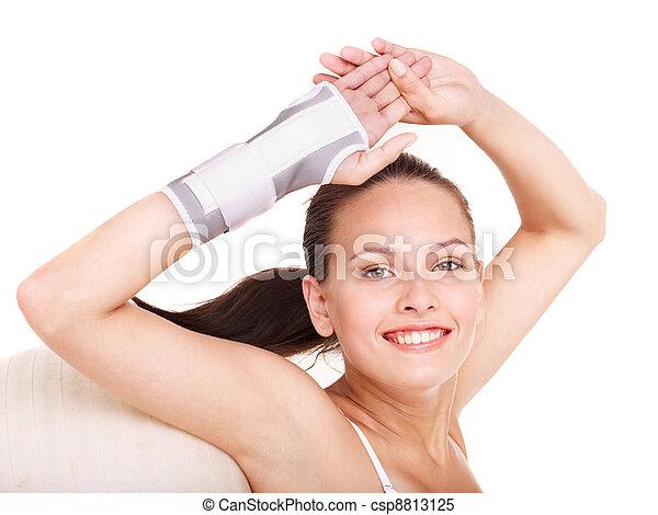 Woman with wrist brace. - csp8813125