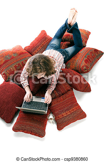 woman working on laptop at home - csp9380860