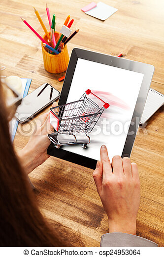 Woman working on tablet - csp24953064