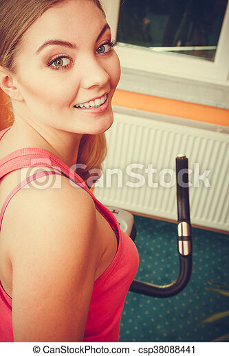Woman working out on exercise bike  Fitness